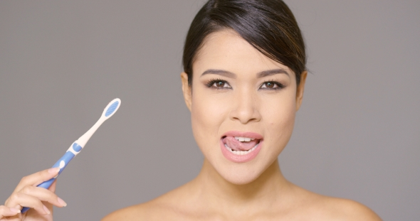 VideoHive Sensual Young Woman Cleaning Her Teeth 19263122