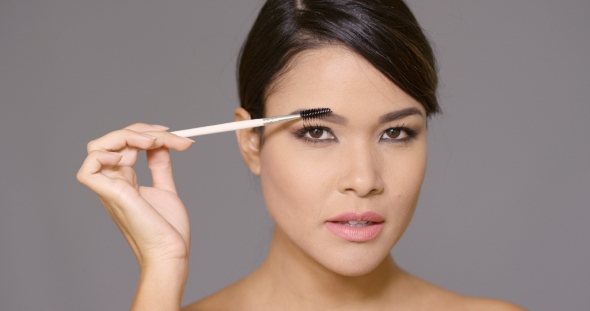 VideoHive Pretty Young Woman Contouring Her Eyebrows 19263187