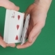 Playing Cards Being Shuffle on a Green Surface By Magician