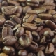 Coffee Beans. Loopable Rotation. Front of the Camera Rotates Plate with Coffee Beans