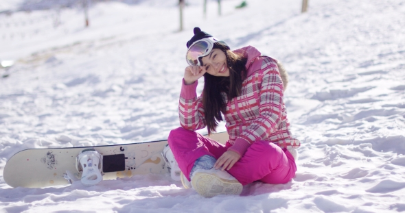 VideoHive Young Woman on Ski Slope with Snowboard 19274683