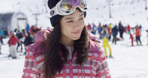VideoHive Young Woman on Skiing Holiday 19274704