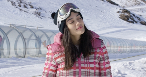 VideoHive Young Woman Relaxing on Ski Slope in Winter 19274715