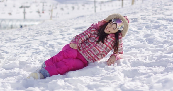VideoHive Young Woman in Pink Snowsuit with Ski Goggles 19274735