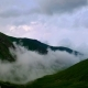 of Fog and Clouds Rolling Over Spring Mountain Green Valley in Kavkaz Region