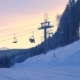 of Ski Chair-lift with Skiers in Snow-capped Mountains at Austrian Alps
