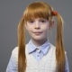 Cute Ginger Girl with Two Pigtails Smiling