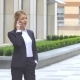 Beautiful Blonde Business Woman on the Phone at Modern Building