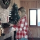 Woman Decorating Fireplace for Christmas