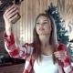 Woman Doing Selfie Against Christmas Decor