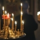 Burning Candles in an Orthodox Church. Icons and Prayer.