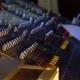 Sound Technician Adjusts a Music Mixer
