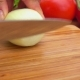 Slicing Onions with Knife on the Board