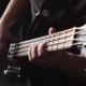 Man Strums and Plays Electric Base Guitar