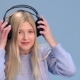 Charming Girl with Headphones Listening To Music