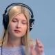 Pretty Girl Listening To Music in Headphones
