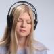 Beautiful Girl with Headphones Enjoying Music