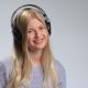 Teenage Girl Wearing Headphones Listens To Music