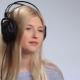 Beautiful Woman Listening To Music in Headphones