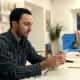 Male Painter Using Digital Tablet in Art Workshop