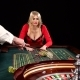 Woman Stakes Piles of Chips Playing Roulette at the Casino