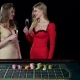 Sexy Young Girls in Casino. Roulette Game. Black