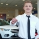 Sales Manager Shows Car Key at the Dealership