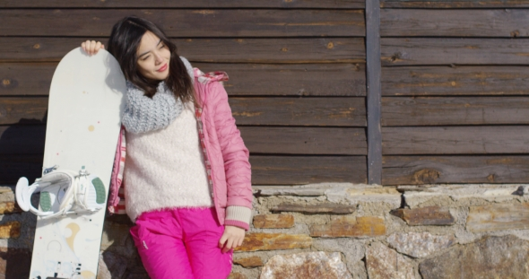 VideoHive Happy Mixed Race Girl Standing with Snowboard 19329826