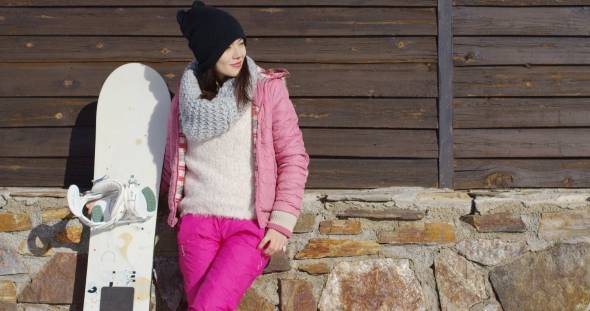 VideoHive Pretty Young Woman with Snowboard 19329992