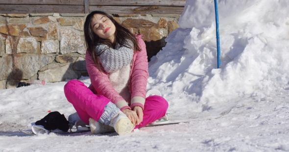VideoHive Young Woman Relaxing on Skiing Holiday 19330023