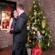 Loving Couple Dancing at a Party, Man Hugging Woman, New Year's Party Near the Christmas Tree, the