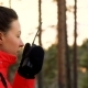 Travel Woman with Binoculars and Transmitter During Sunset Lights in the Forest