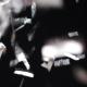 Silver Confetti Falling Over Black Background 13