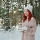 Flame Candles, Pretty Girl with Red Hair Holding a Burning Candle in Hands, Warming Fire in Winter