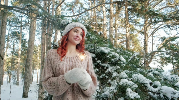 Girl Holding a Sparkler, Beautiful Girl in the Winter in the Woods, Winter Nature, Winter Fairy Tale