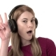 Beautiful Woman with Headphones Listens To Music and Making Silly Gestures. Crazy Dancing. Isolated