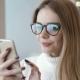 Woman Taking Self Portrait Outdoors Sharing Photos Social Media