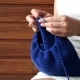 Young Woman Hands Knitting a Blue Scarf