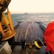 View From the Bridge Deck of the Tug on Anchor Buoy. Powered Winch. Daytime. Swell on the Baltic Sea