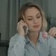Happy Female Office Worker Talking on the Phone and Holding Rose