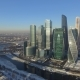 Business Center Moscow City in the Winter Day Aerial  Flight Around the Skyscraper on Drones