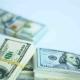 US Dollar Bundles Falling on White Surface. Wages, Arnings, Winnings