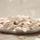 Pumpkin Seeds Falling Down Into Glass Bowl
