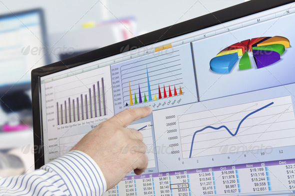 Analizing Data on Computer - Stock Photo - Images