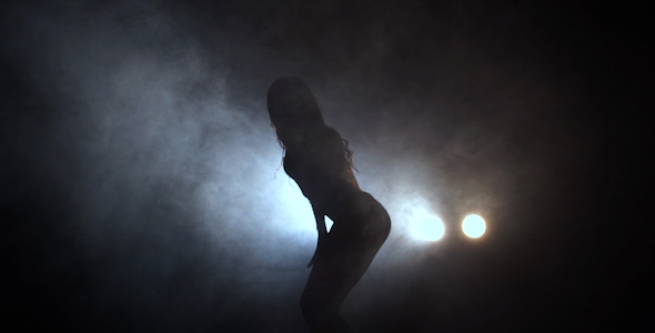 VideoHive Silhouette Of a Girl Dancing On The Background Lights 16795477