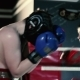 Men Inflict Punches in the Boxing Gloves.