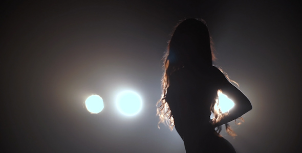 VideoHive Silhouette Of a Girl Dancing On The Background Lights 16795423