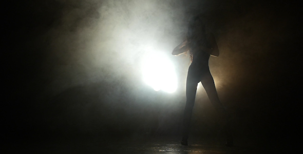 VideoHive Silhouette Of a Girl Dancing On The Background Lights 16795570