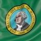 Waving Flag of Washington Against Blue Sky