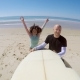 Cheerful Couple with Surfboard